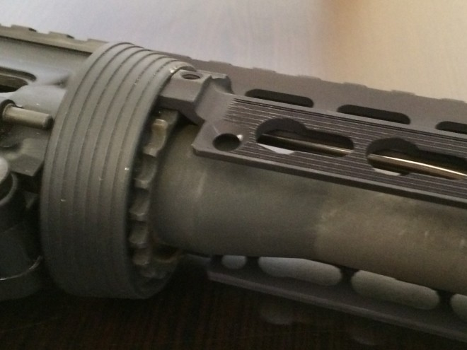Installing the top part of the handguard.