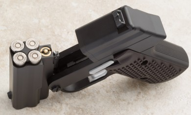 Picture of the open action, the brass-colored button below the chambers is the optional laser actuator