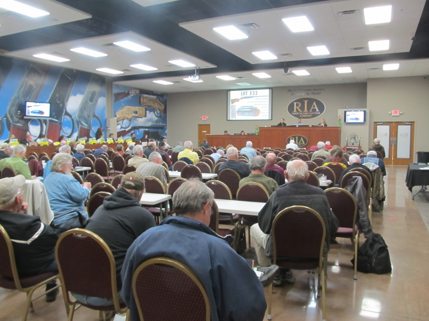 The main Auction Hall during the auction. Telephone and internet bidders are on the far right.
