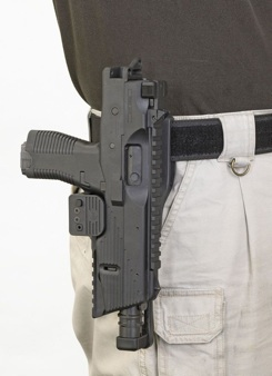 The MP9 is small enough to be holstered (pictured here without side folding stock)