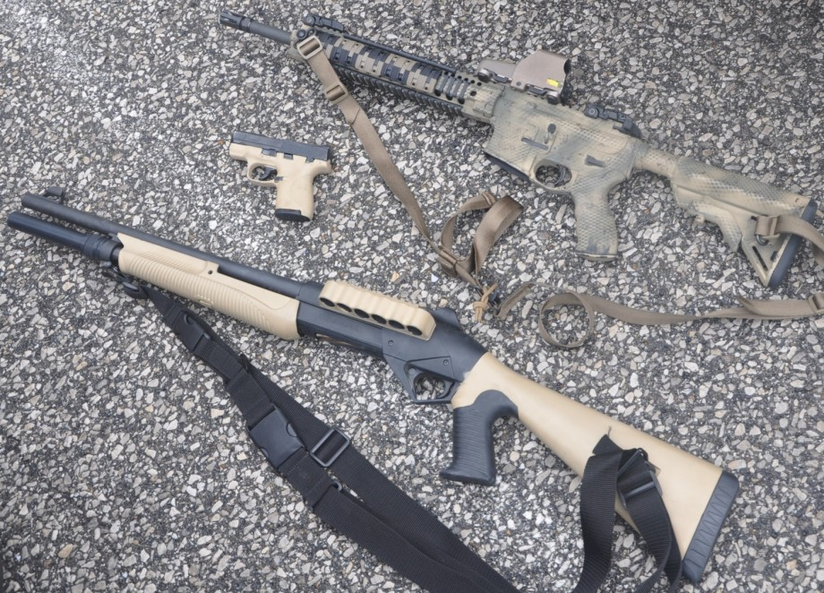 Potd Spray Painting A Rifle A Shotgun And A Pistol The