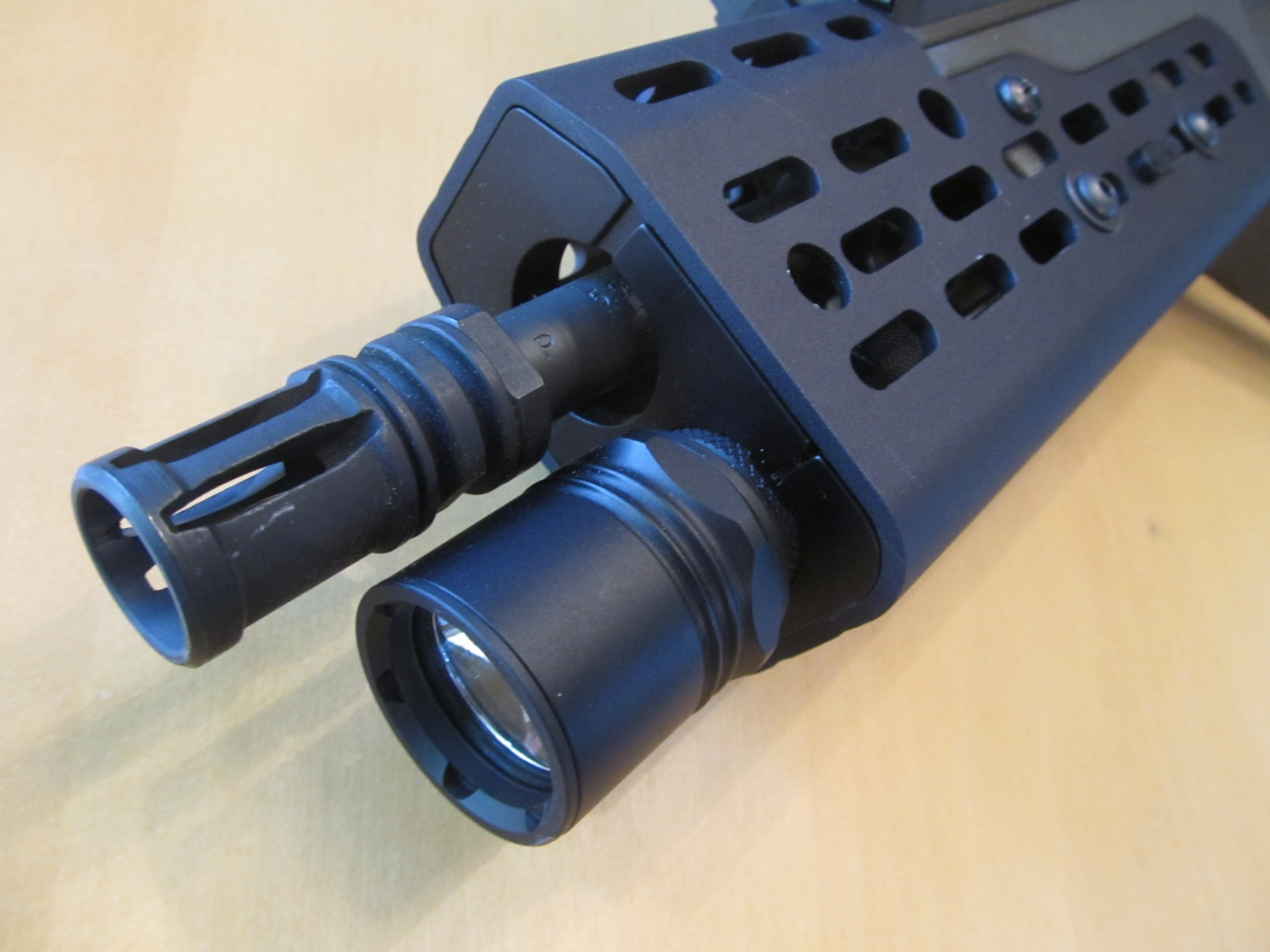The Archlight XTL forend on an 18 inch Tavor rifle. This product has a number of unique features such as monolithic construction, and the ability to place a light ring at multiple spots within the forend.