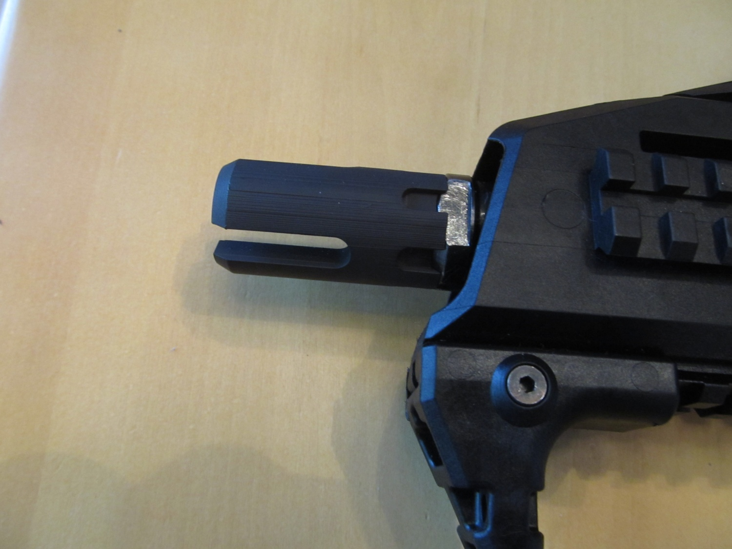 A rough rapid prototype of the suppressor adaptor and muzzle compensator that Manticore has come out with.
