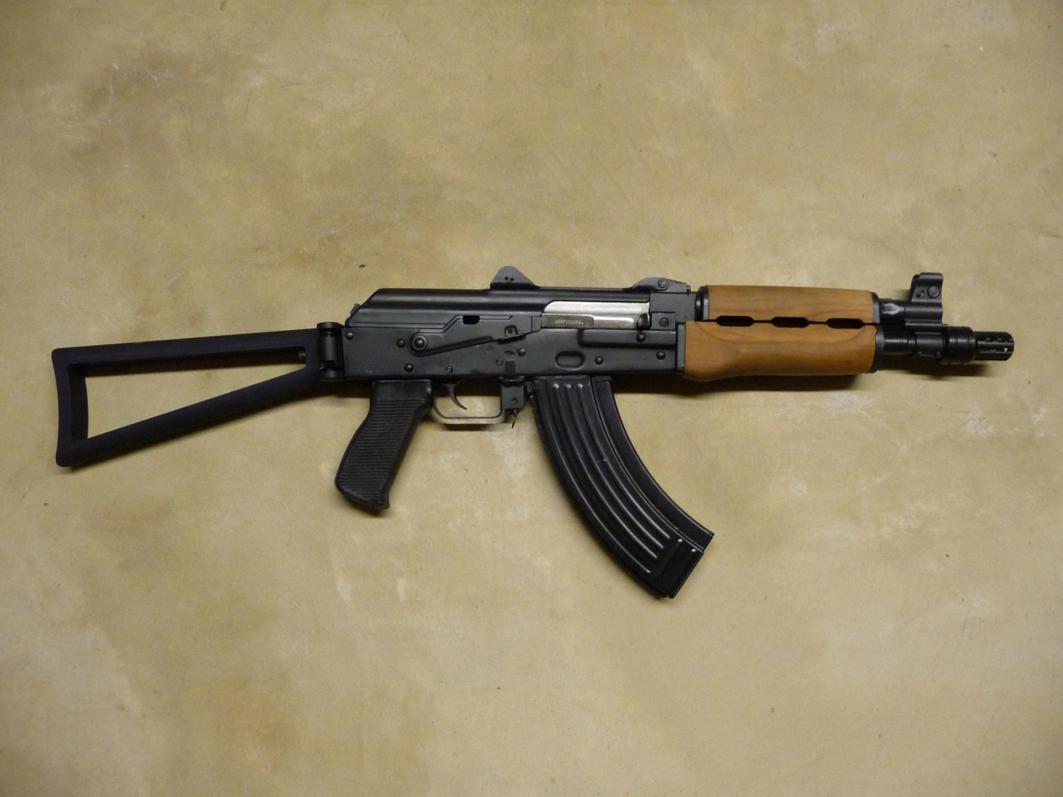Triangular stock on a Yugo M92. Traditional AK74 stocks are stamped, whereas Manticores are cast.