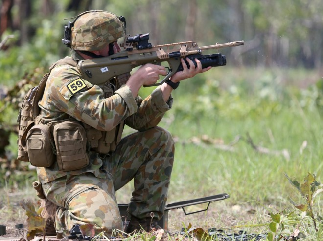 Private Jackson Bartlett from the 5th Battalion Royal Australian Regiment pulls the newly position trigger on the new Grenade Launcher Attachment (GLA) on an EF88 Austeyr weapon at Kangaroo Flats firing range, outside of Darwin.