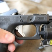 The screw on the right hand of the trigger would allow you to completely disassemble the trigger. Its always covered when installed, so its not backing out. Still, recommend blue Loc-Tite.
