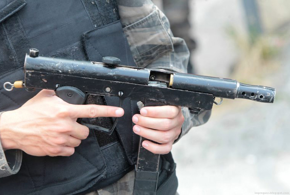Improvised semi automatic pistol with paintball frame