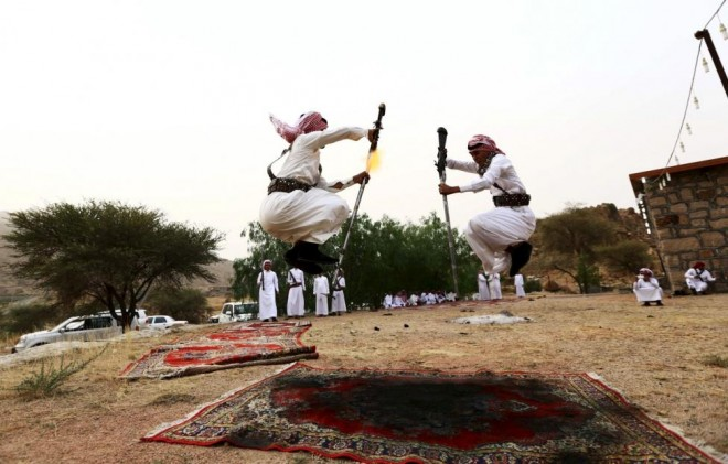 Men dance during a traditional excursion near the western Saudi city of Taif, August 8, 2015. REUTERS/Mohamed Al Hwaity