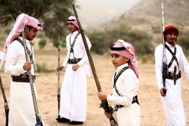 People pose for a photo during a traditional excursion near the western Saudi city of Taif, August 8, 2015. REUTERS/Mohamed Al Hwaity
