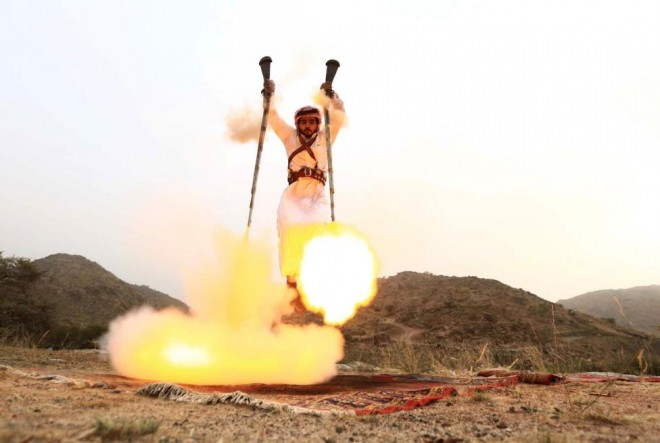 A man fires weapons as he dances during a traditional excursion near the western Saudi city of Taif, August 8, 2015. REUTERS/Mohamed Al Hwaity