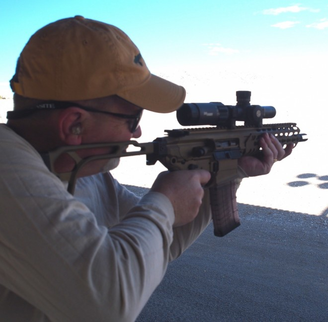 Phil shooting the SIG MCX carbine at SHOT 2015. This is a great carbine and very accurate. SIG 1x6 optic.