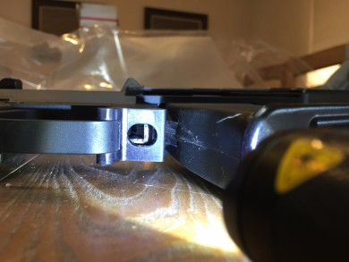 Bottom view of the bullet button and magazine release.