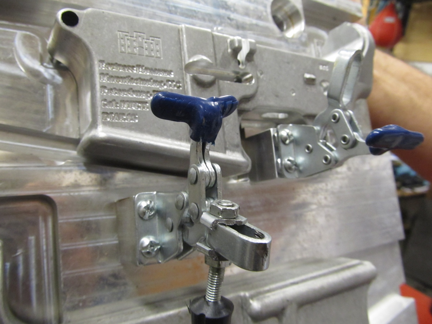 Some of the jigs the company uses to hold the receiver in place.
