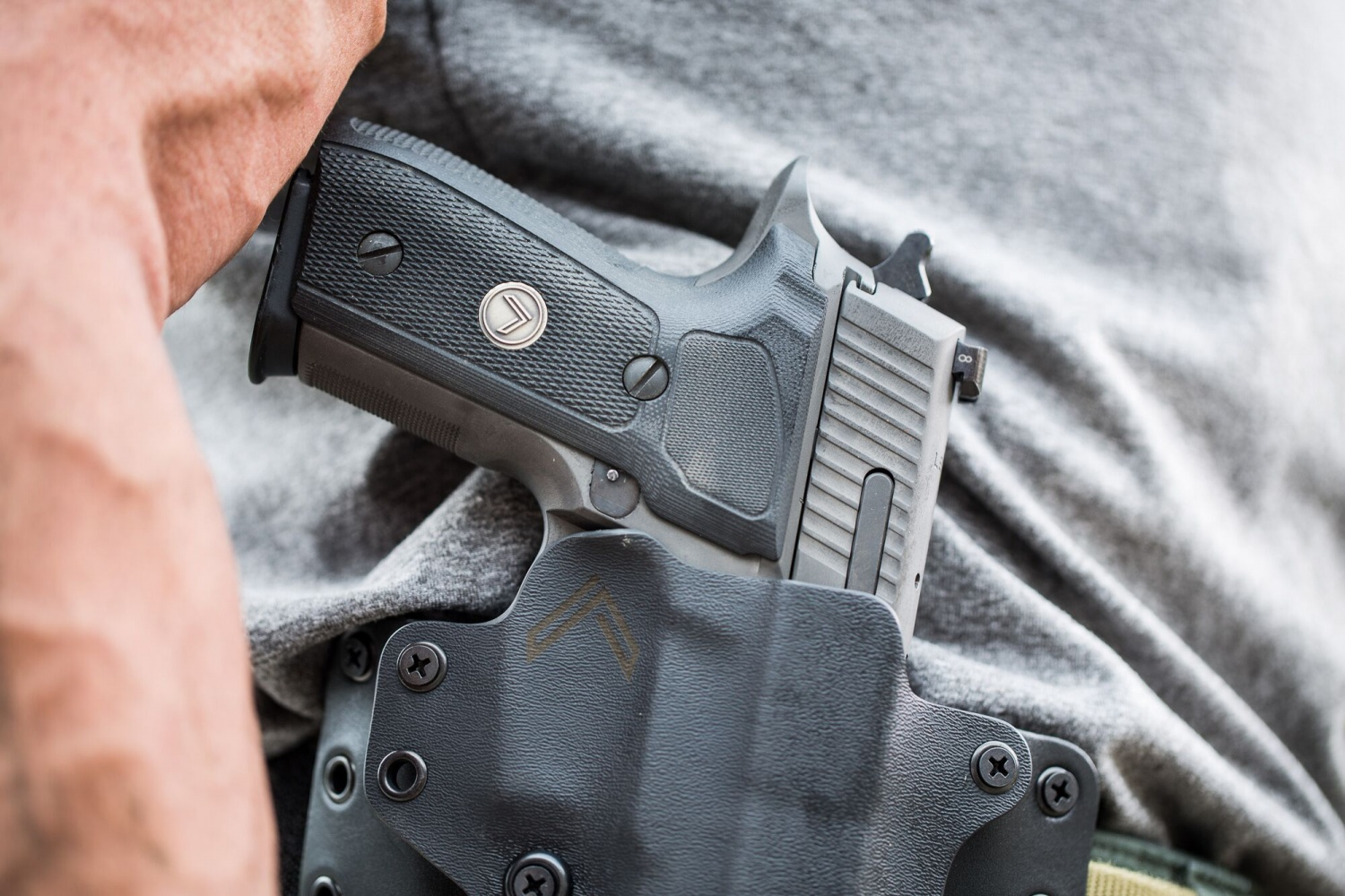 P-229 in the Black Point holster which sports the Legion logo.