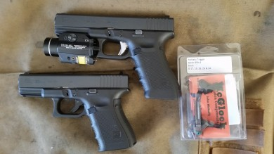 My T&E Glocks, which also happen to be my EDC firearms. Glock 22 and Glock 23, with various mods. The G23 has the Lone Wolf UAT installed.