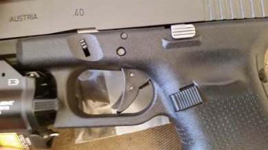 Close-up of pre-adjusted trigger location. The visible gap in the passive safety was easily removed using the adjustments.