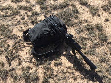 Rifle with pack as a rest.