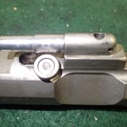 bolt carrier with roller cam pin and integral gas key