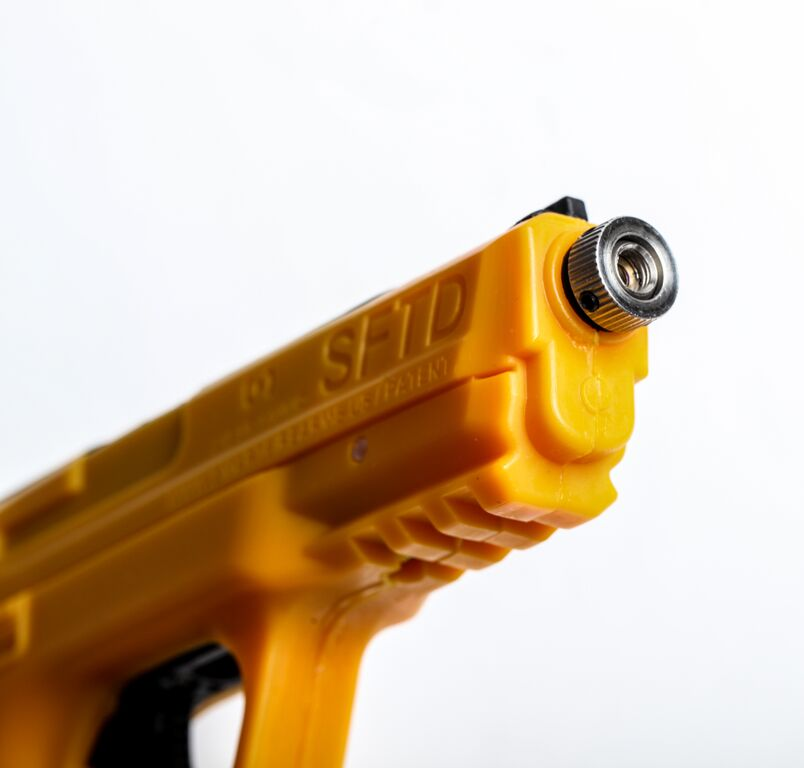 Training pistol that can help correct bad trigger behaviors by sounding an alarm when you finger the trigger with out shooting. It also projects a laser for use with their targets.