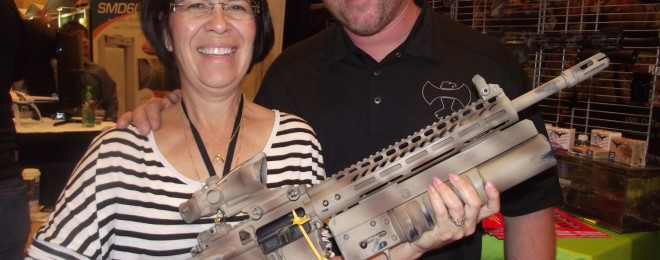 Cindy Dietz and Jeff Axelson with the Danny Dietz Tribute Rifle