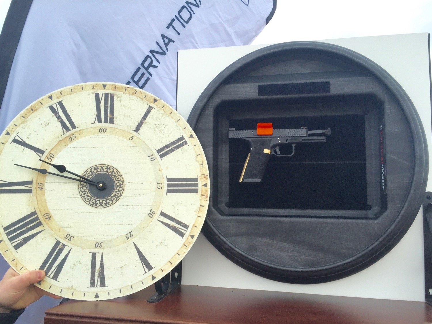 Clock face removed, exposing the compartment