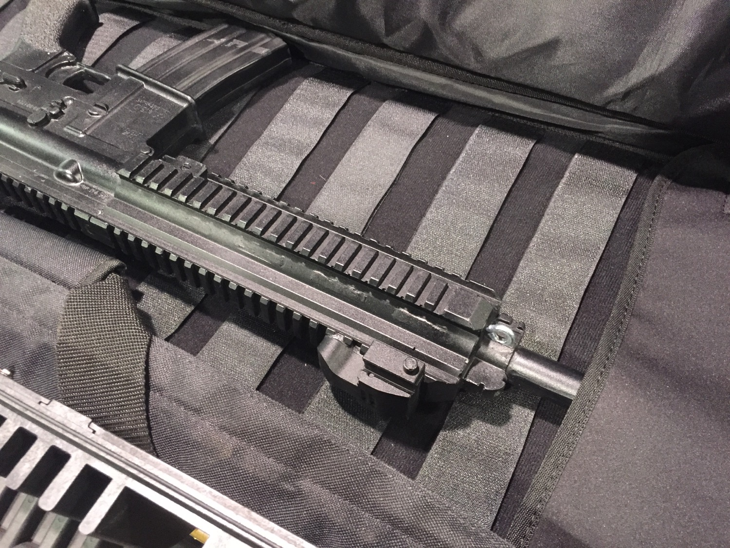 Rifle case with a soft insert that is layered with loop fastener (allowing you to secure things how you like)