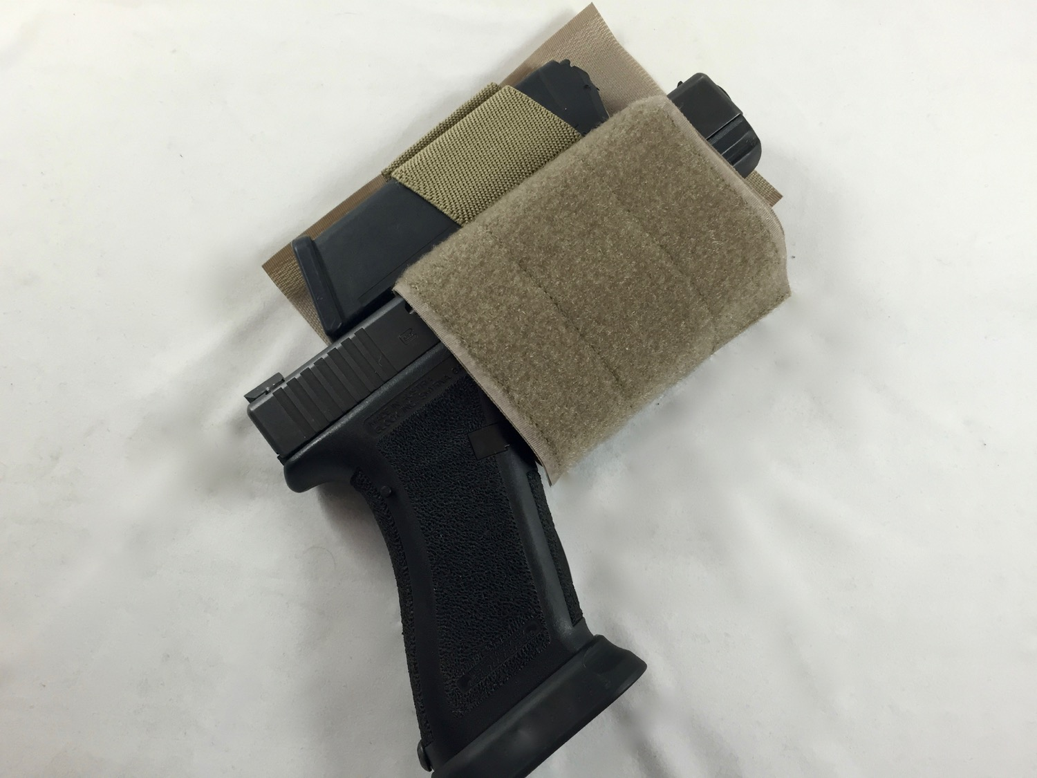 Simple hook and loop based holster for a sidearm and a magazine.