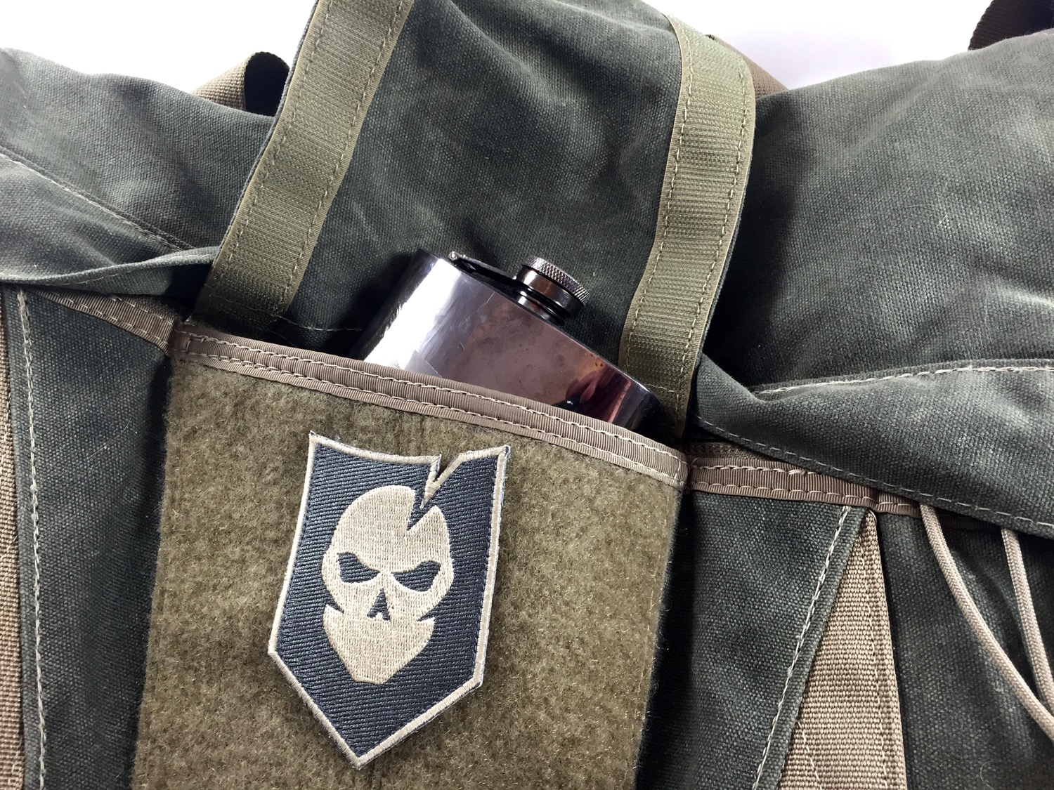Hidden compartment runs the full size of the messenger bag lid.