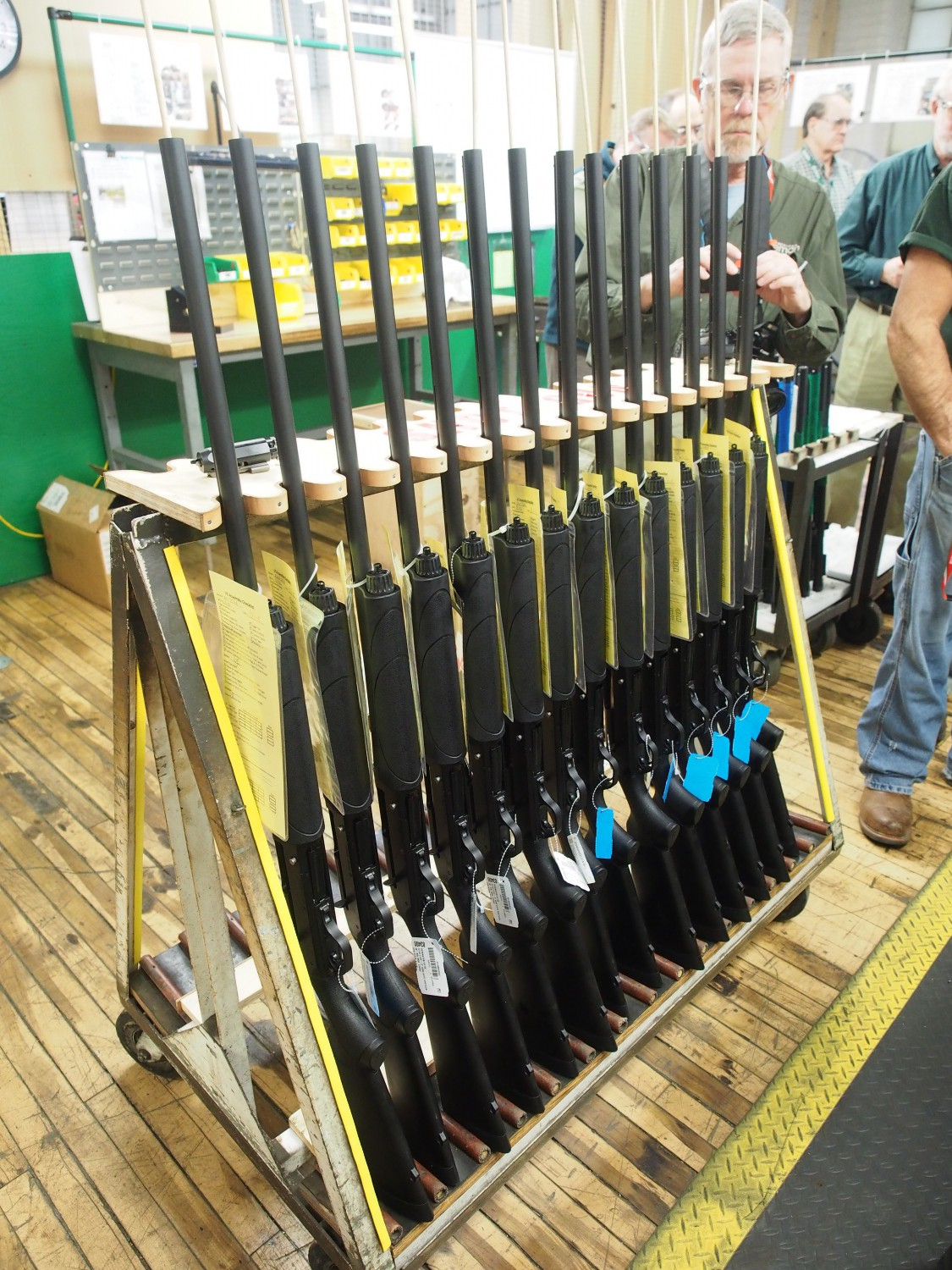 Completed shotguns in the rack waiting for inspection and packaging.