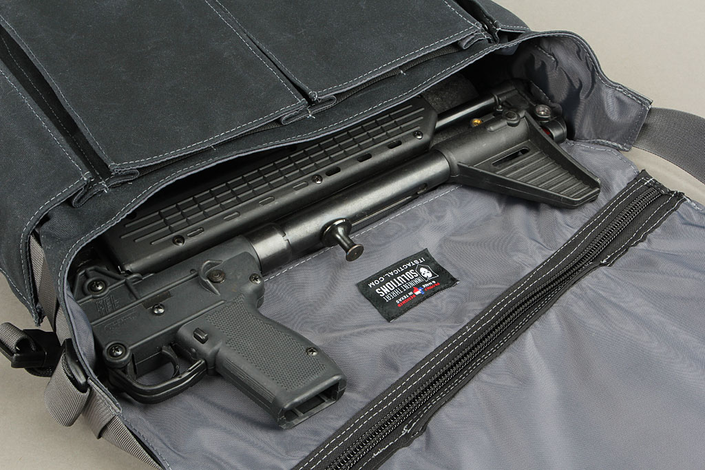 It can hold a folded Kel-tec Sub2k (assuming you have one or can find one)...