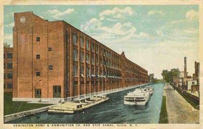 Early view of the Remington plant showing the Erie canal running  beside the plant. Today it's a driveway by the front entrance to the plant.