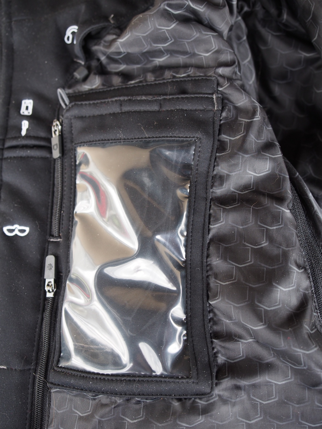 Right side pocket for cell phone or IPad. Next to it is the sunglass pocket and an opening to run ear buds.