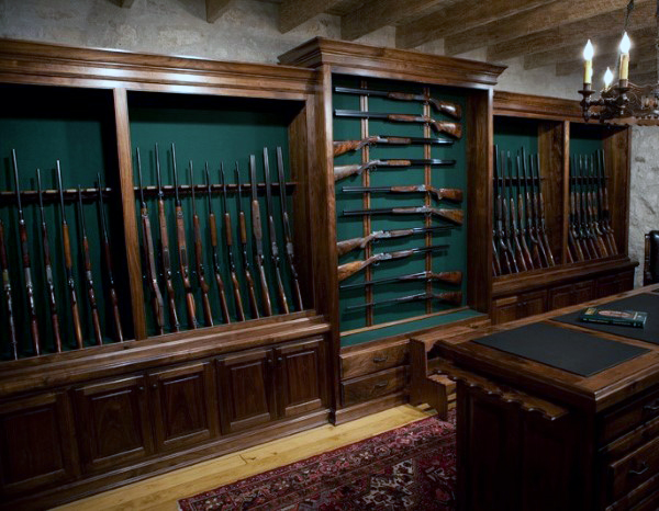 gun-collector-room-with-rifles-and-shotguns-mounted-on-wall-rack