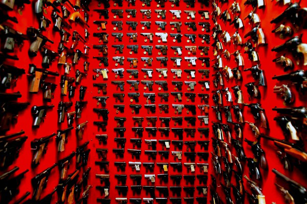 incredible-room-with-wall-mounted-pistols-and-red-paint