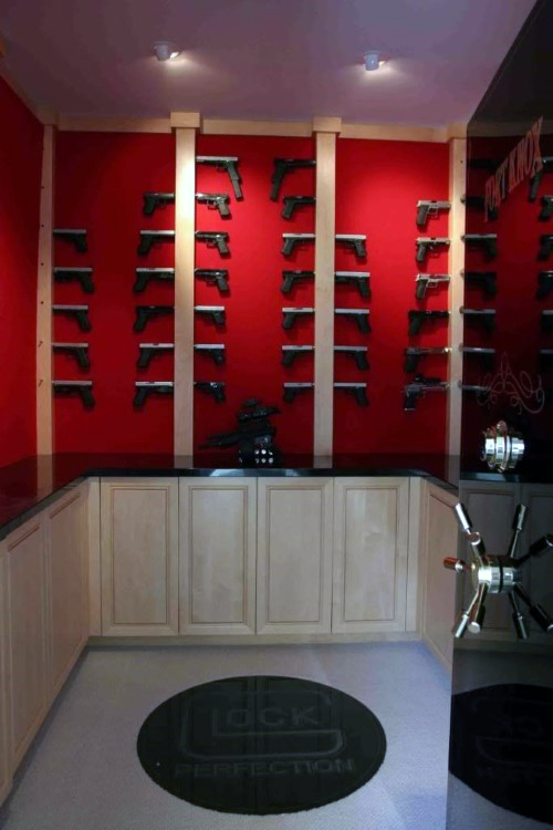 walk-in-gun-room-safe-with-red-walls-glock-themed