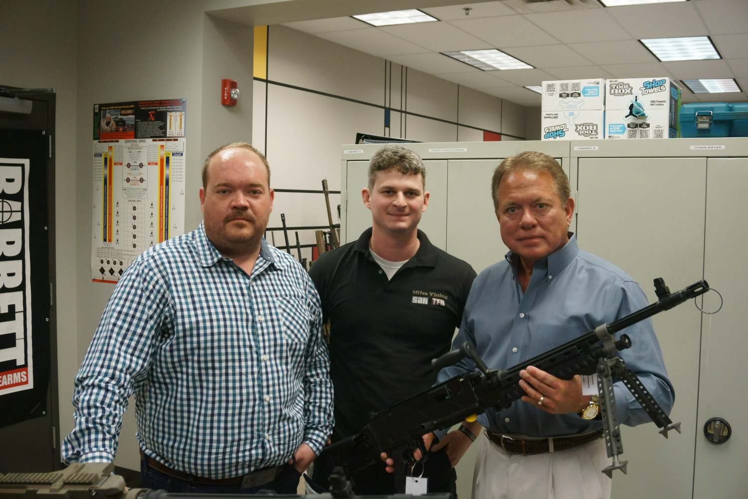 Christopher Barrett, the current company President left, and Ronnie Barrett, his father, right, with a prototype Barrett 240 Light Weight.