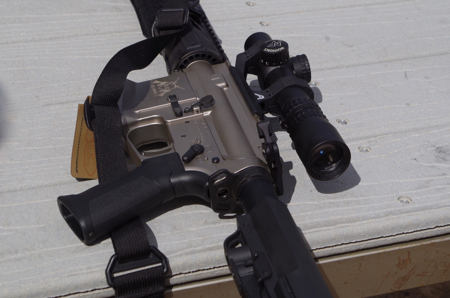 Rifle with optics is allowed in Tactical (Optics) Division, but not with pistol and shotgun also outfitted.