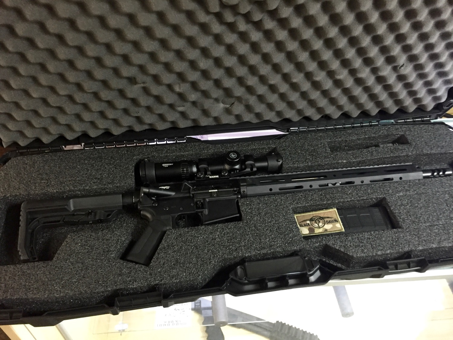 Simple box, rifle, mag and some lube.