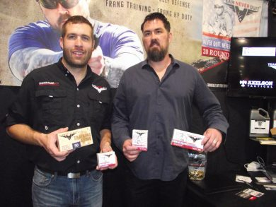 SRSP Founder Casey Betzold and Marcus Luttrell with boxes of Team Never Quit ammunition