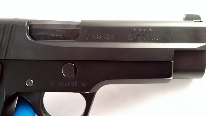 This short-recoil operated SIG P220 uses a tilting-barrel locking mechanism. You can see how the slide is prevented from moving rearward by the front surface of the barrel in this image.