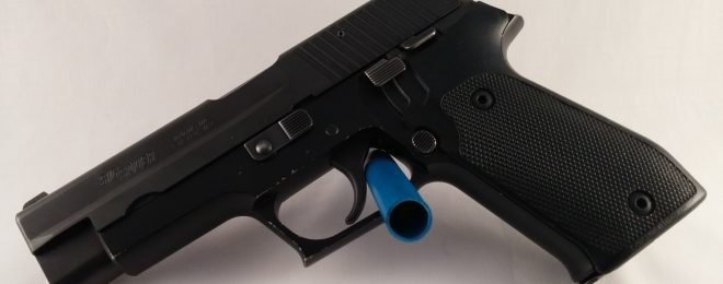The author's beloved 1990 manufacture SIG P220 DA/SA handgun. I carry a Glock, though.