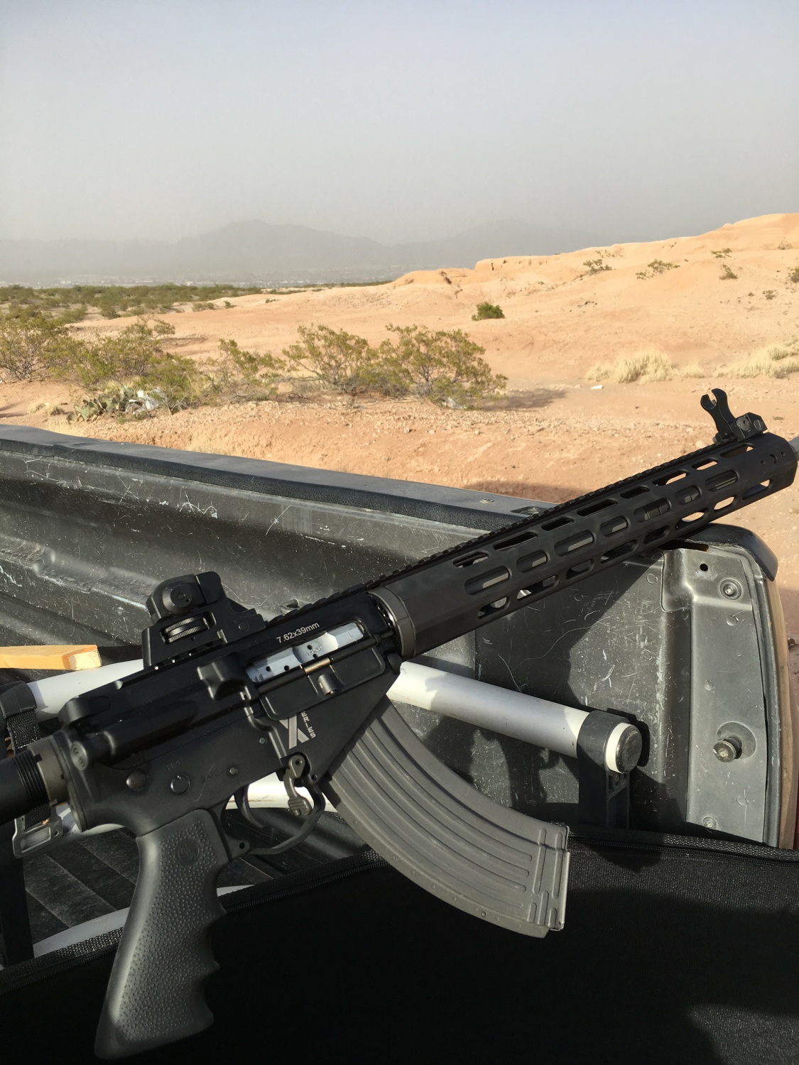 Out playing with the LAR-47 X-1, trying various ammunition and magazine types. Note a good ole' El Paso sandstorm in the background.