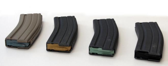 The EPM (left) alongside the older tan, green, and black follower 30 round USGI magazines.