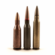 A 5.45x39mm 7N6 cartridge, flanked by two of its predecessors. The 5.6x39mm (left) was developed from an early Soviet ballistic test round using the 7.62x39mm case head, which was designed to duplicate the performance of the early .222 Remington Special (right), later renamed the .223 Remington.