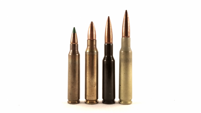 On the right are the two major iterations of the 6mm SAW, the 45mm steel cased version, and the 50mm aluminum cased version. In the middle is a modified .25 Winchester experimental round used for ballistic testing in the early part of the SAW program. On the far left is 5.56mm M855, which became the eventual chambering for the resulting M249 SAW.
