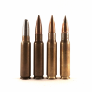 On the right are two types of 7.62 NATO round, the M80 and M80A1, alongside two of its predecessors. Center left is the .30 T104 ball cartridge using the 1948 T1E1 case. Left is the .300 Savage, which was the starting point for what became the 7.62 NATO.