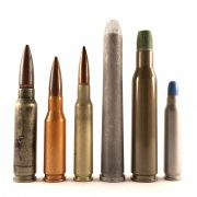 Aluminum cased rounds, left to right: .30 T65 Light Rifle aluminum experimental, .280/30 British aluminum experimental, 6x50mm SAW aluminum experimental, 9.53x76mm Winchester quadruple flechette, .330 Amron Aerojet triple flechette. Today, aluminum cases are only used in low pressure applications, like the Omark Industries short range training round on the far right.