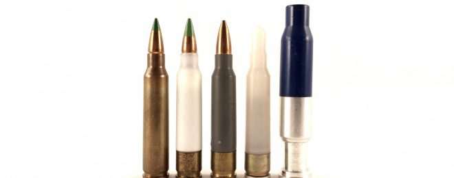So far, the polymer composite case has only found purchase with low-power specialty ammunition, such as the plastic blank and fired 7.62mm UTM marking round, both on the right. Several commercial composite cased rounds have been tried, including the grey .223 Remington PCA ammunition. In the 1970s, Frankford Arsenal and AAI experimented with composite cased ammunition, represented by the white cased round in the middle. On the left is a standard Korean-made M855 round.