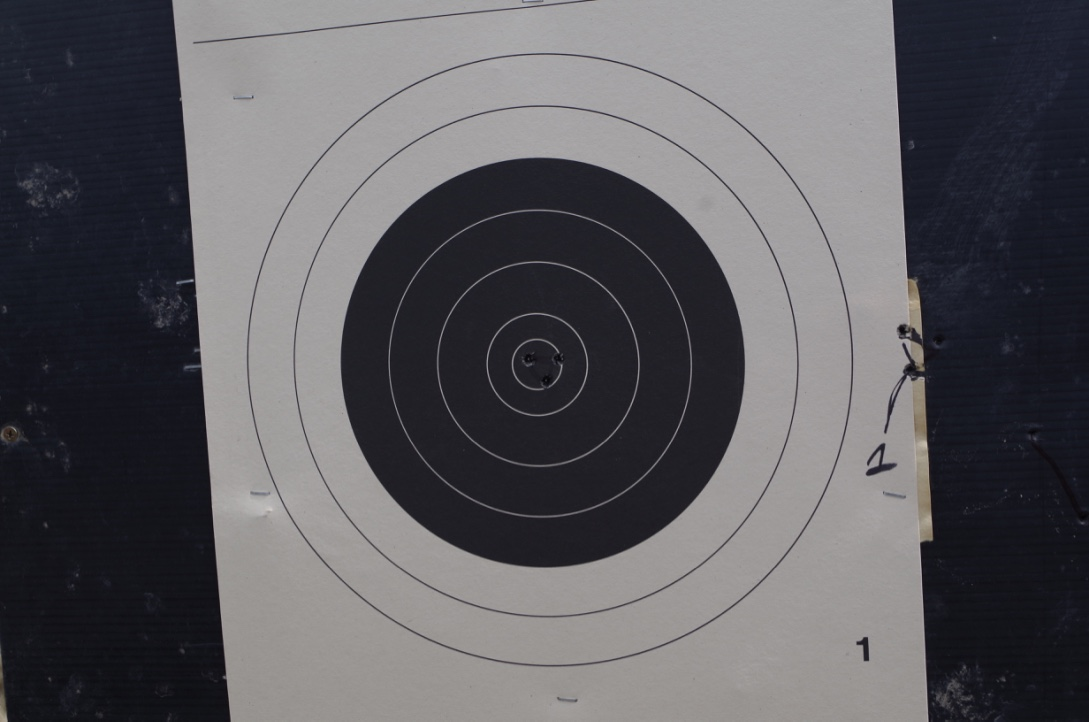 Once we got on paper, the first three shots were on the edge. We adjusted the windage, and, well, you can see the results...