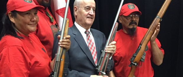 Associate-Minister-of-Defence-Julian-Fantino-centre-poses-with-members-of-the-Canadian-Rangers-at-the-Colt-Canada-plant-in-Kitchener.-Albert-Delitala